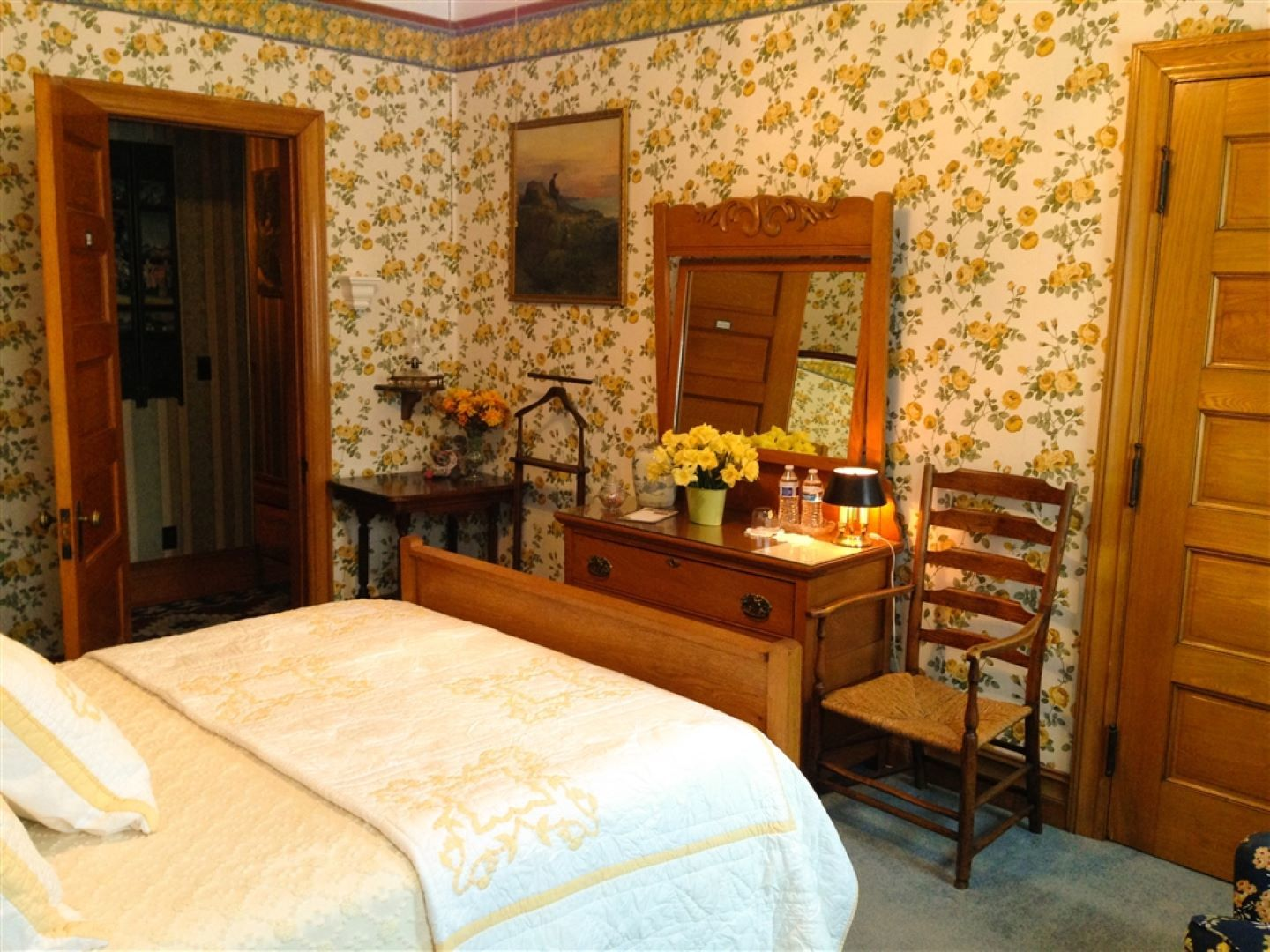 A bedroom with a bed and desk in a room at The Dempsey Manor Inn.
