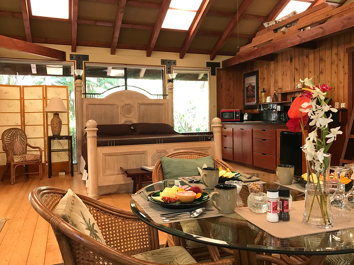 A kitchen with a table in a restaurant at Volcano Village Lodge.