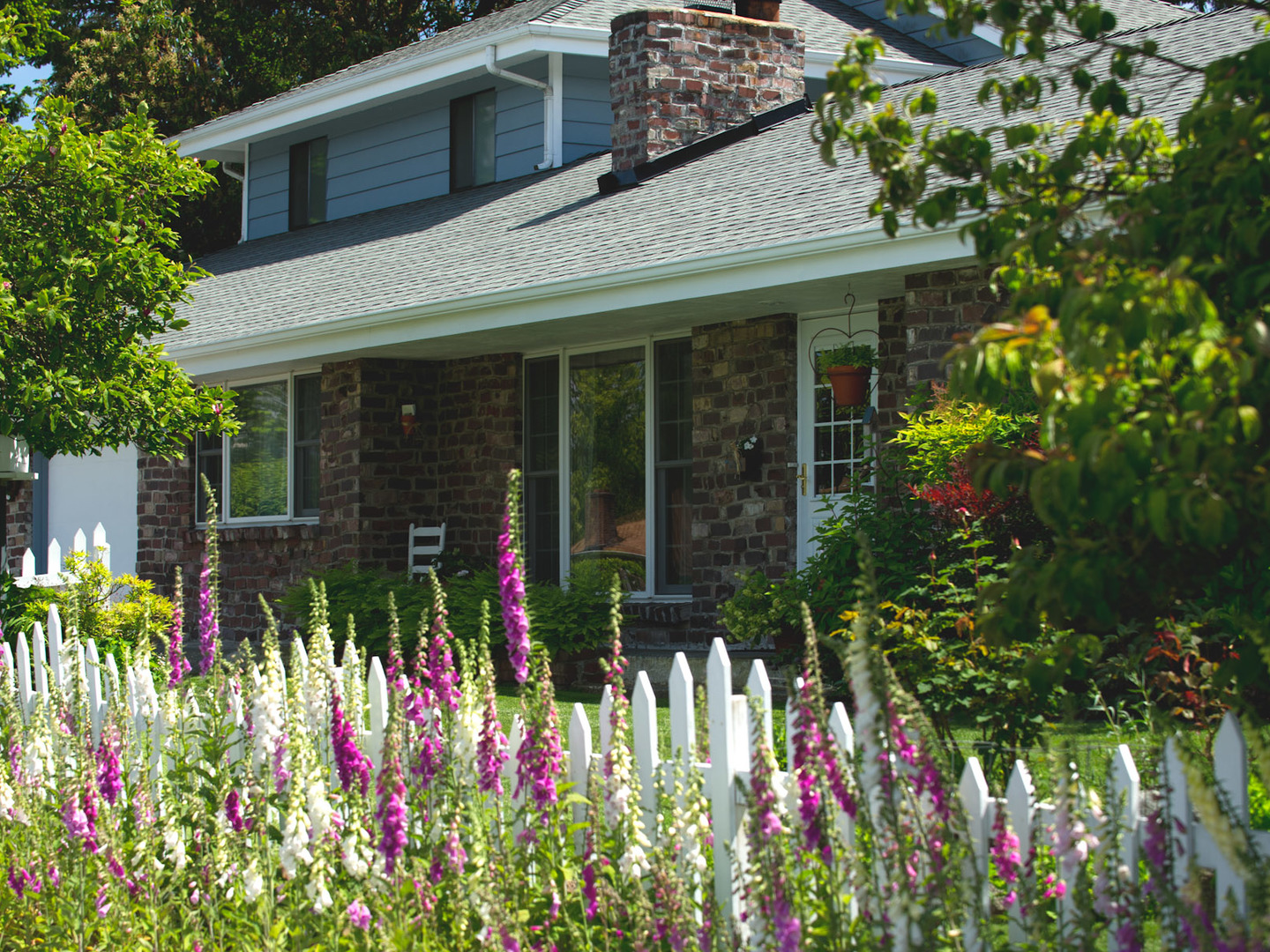 A colorful flower garden in front of a building at The Guest House Bed & Breakfast.
