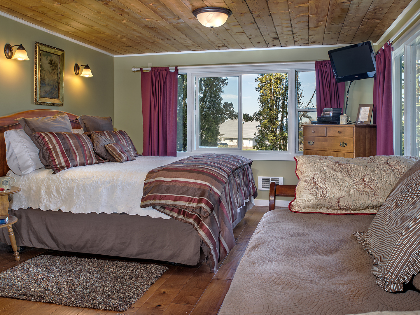 A bedroom with a large bed in a room at The Miller Tree Inn.