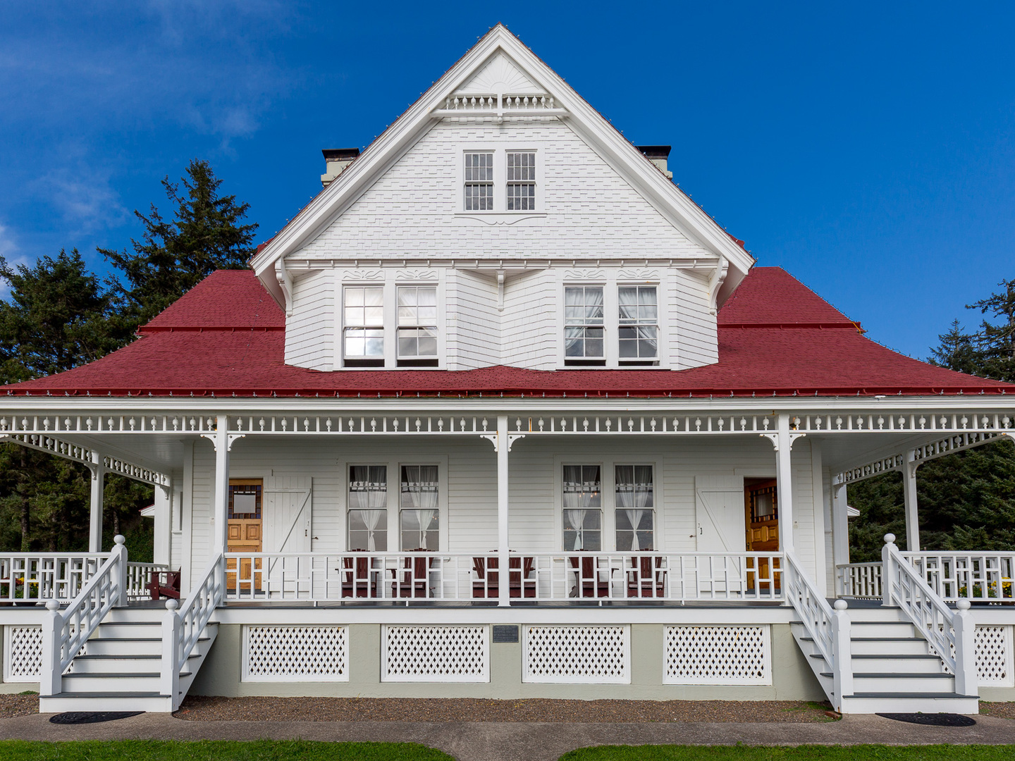 A large white building with pillars in front of a house at Heceta Lighthouse B&B.