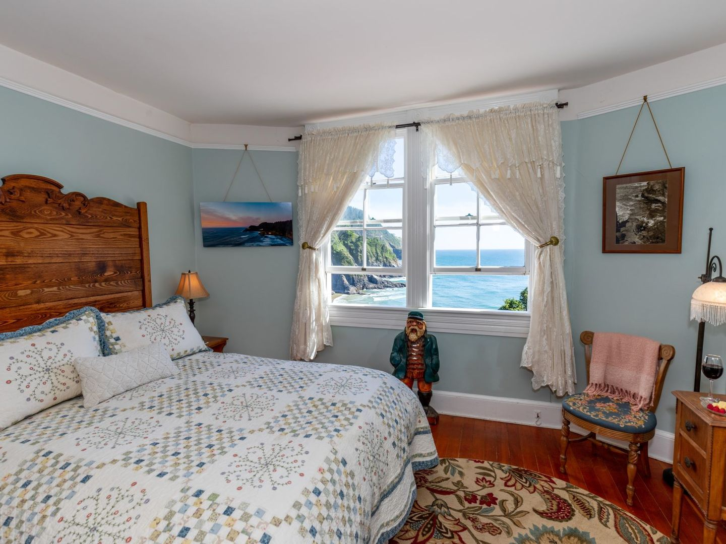 A bedroom with a bed in a room at Heceta Lighthouse B&B.
