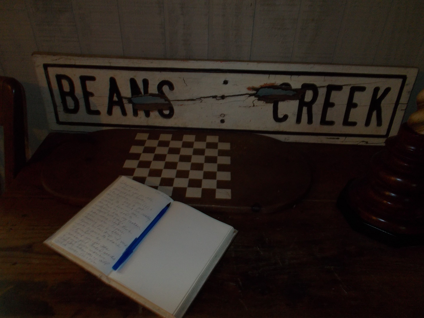 A sign on a table at Beans Creek Ranch Cabin.