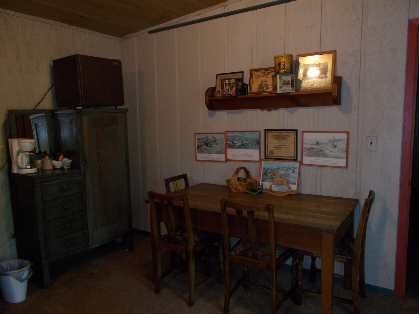 A kitchen with a table in a room at Beans Creek Ranch Cabin.