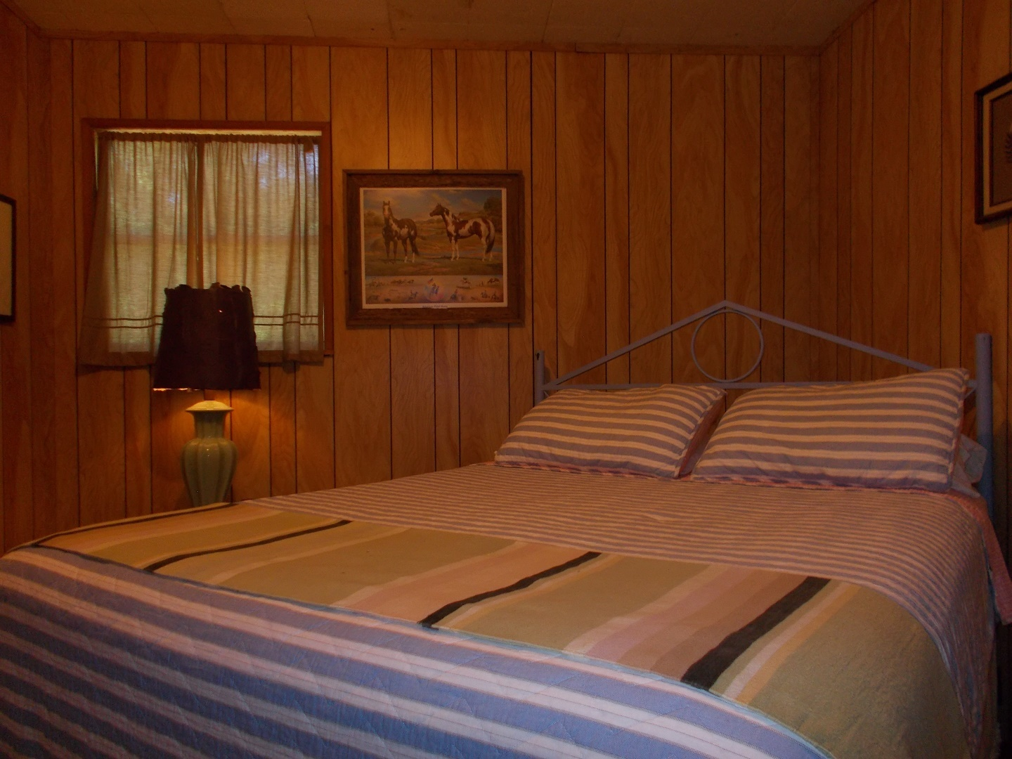 A bedroom with a bed in a room at Beans Creek Ranch Cabin.