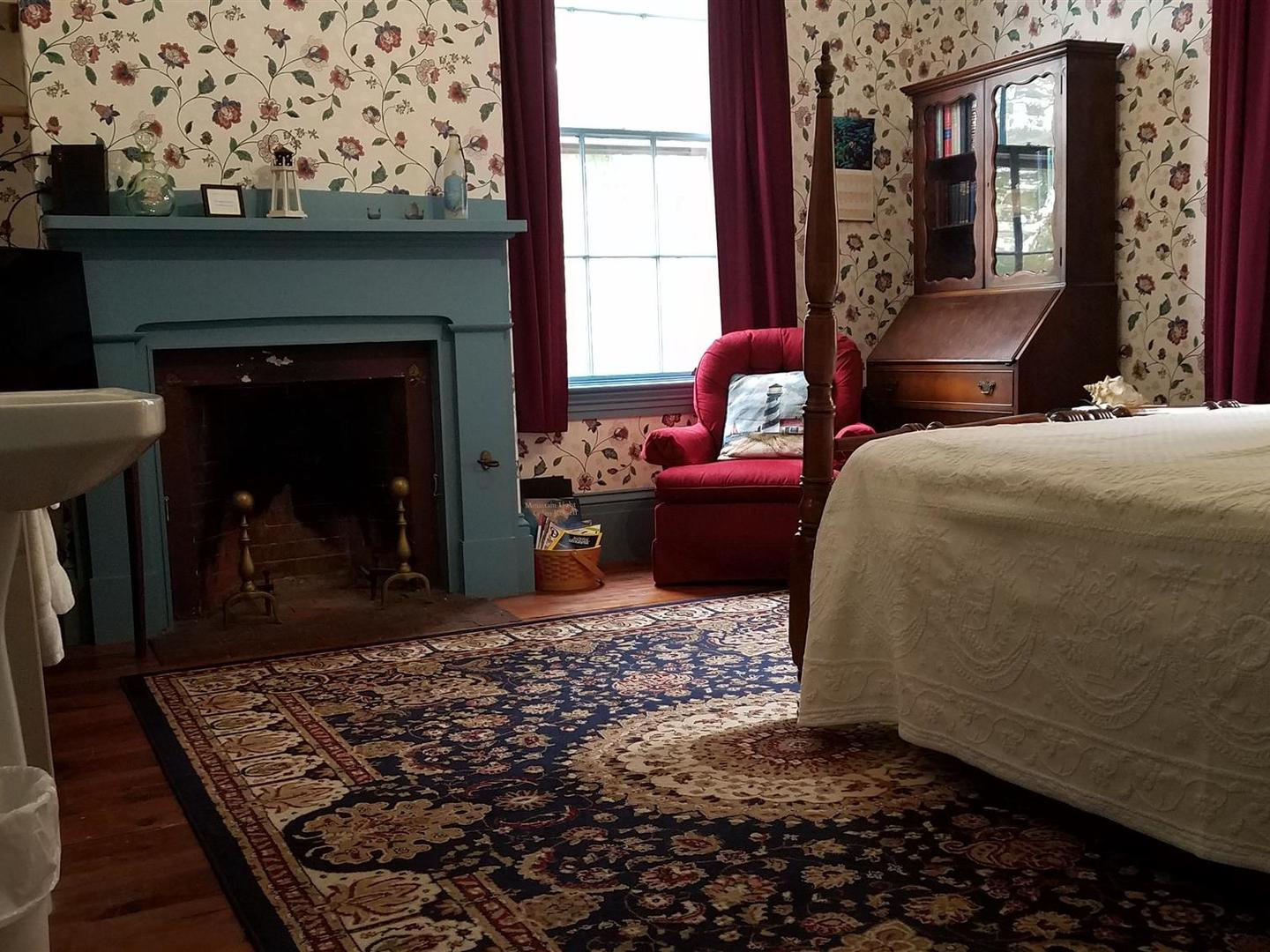 A bedroom with a large bed in a room at The Jeremiah Mason House Bed and Breakfast.