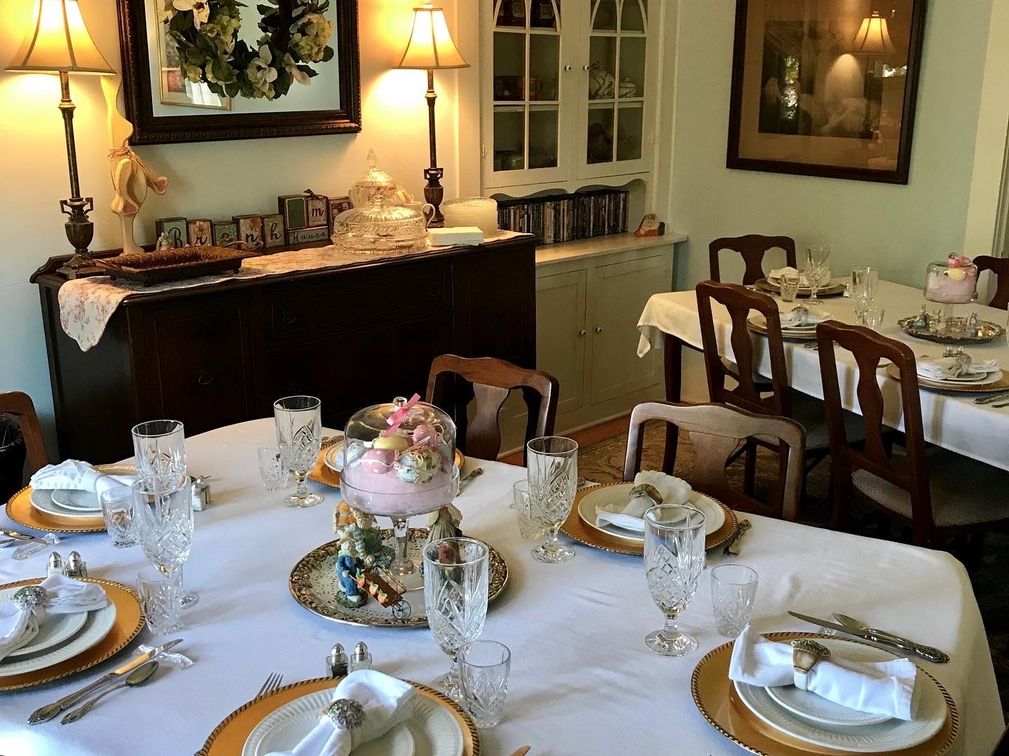 A dining table with a cake on a plate at Brenham House Bed and Breakfast.