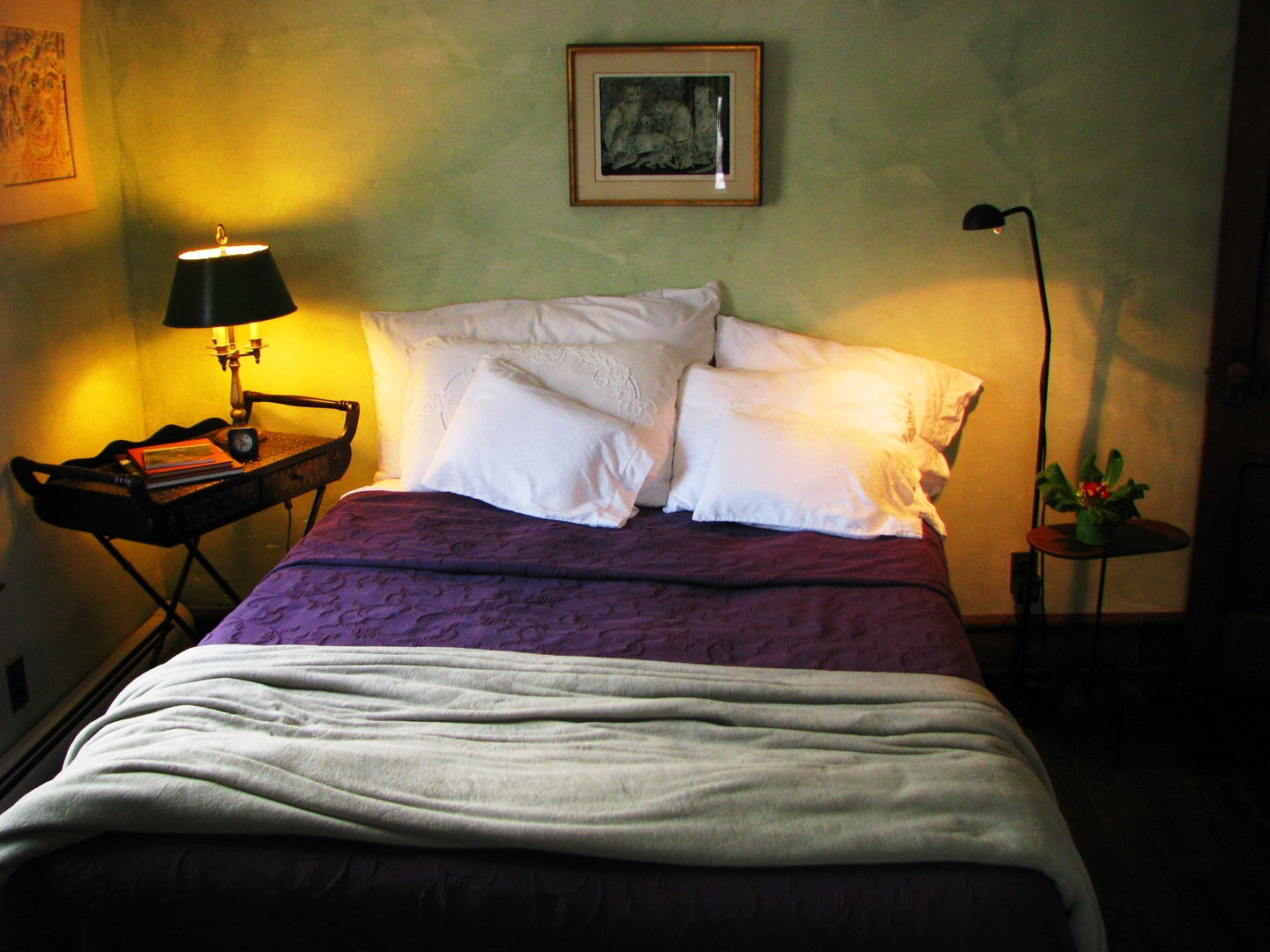 A bedroom with a large bed sitting in a room at One of a Kind Bed & Breakfast.