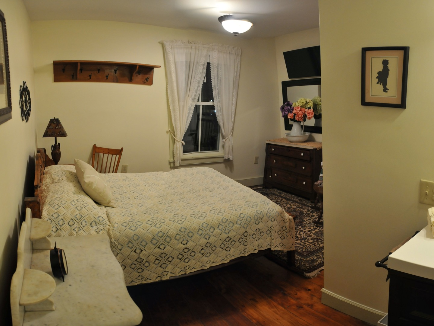 A bedroom with a bed and a mirror in a room at Fulling Mill Inn and Restaurant.