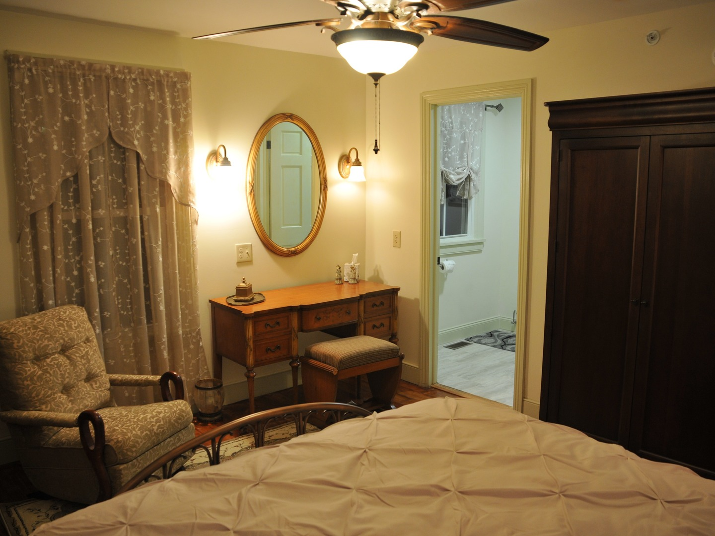 A bedroom with a large bed in a room at Fulling Mill Inn and Restaurant.