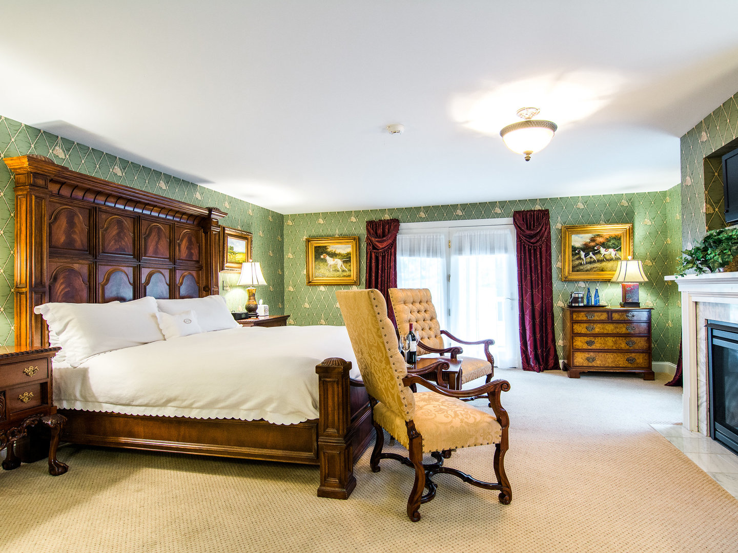 A bedroom with a large bed in a room at Antrim House.