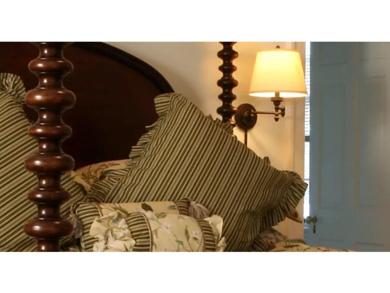 A zebra stands in a room at Charred Oaks Inn.