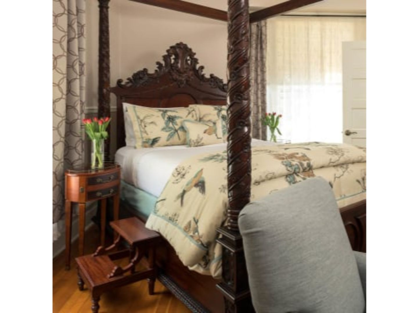 A bedroom with a bed and a chair in a room at Albemarle Inn.