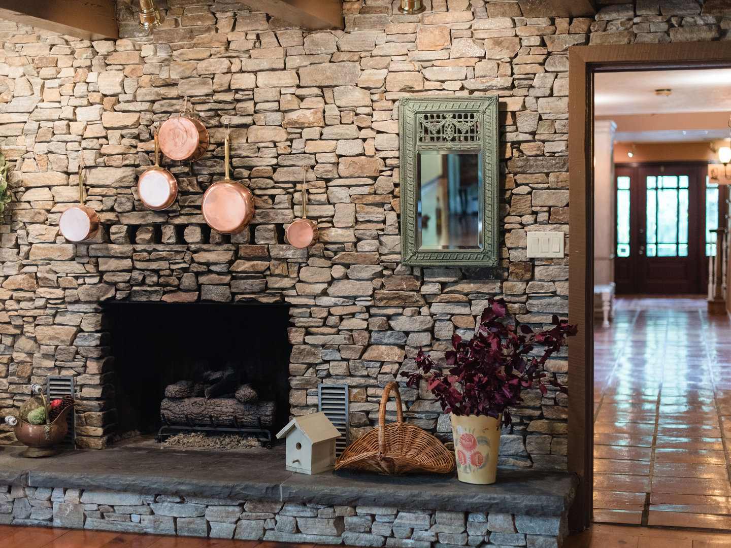 A fire place sitting in front of a brick building at The Inn at White Oak.