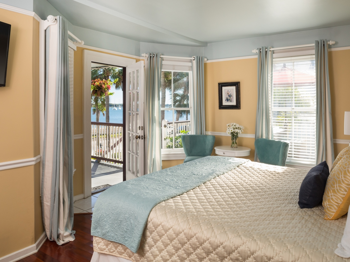 A bedroom with a large bed in a room at Bayfront Marin House.