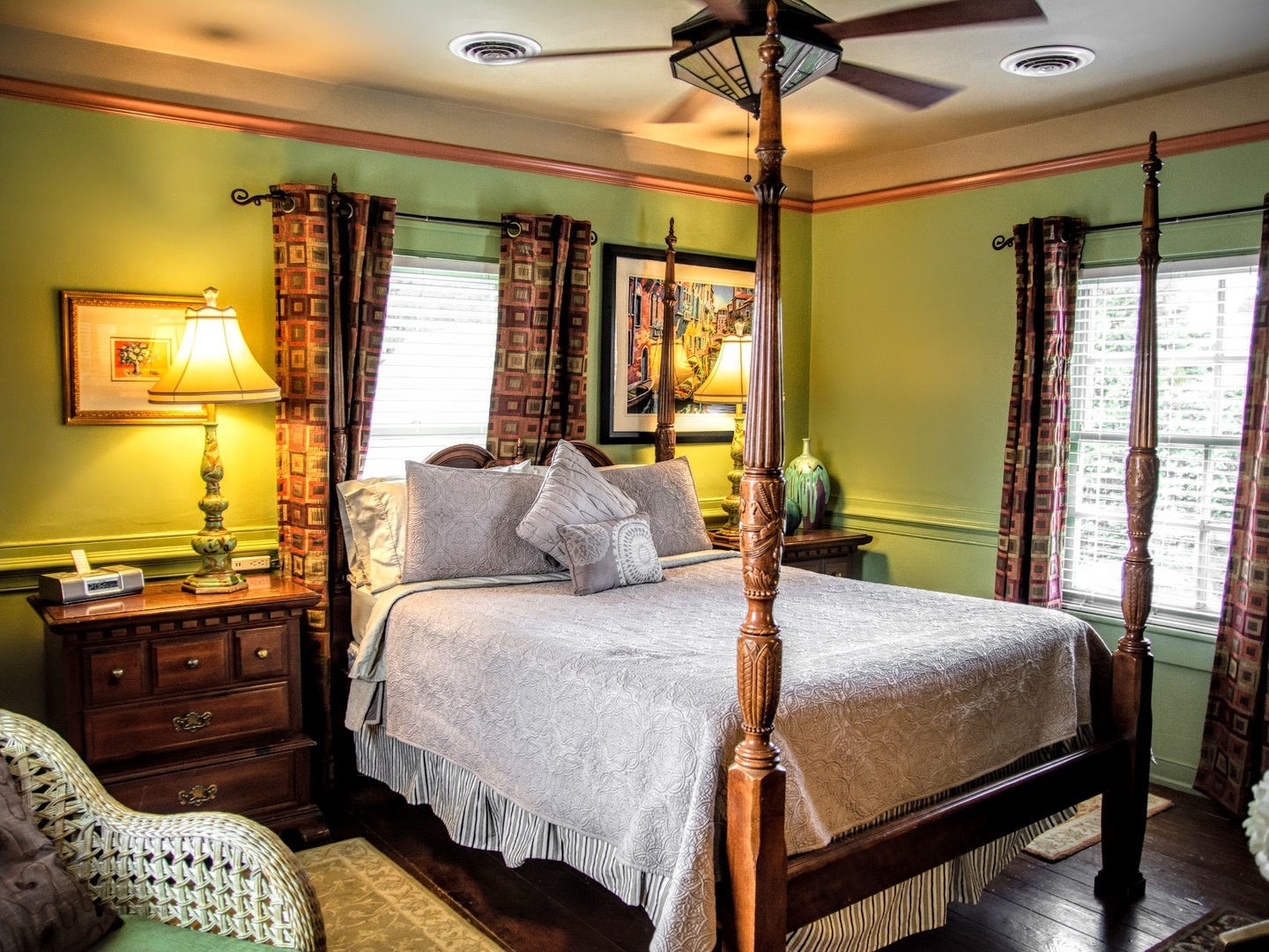 A bedroom with a bed and a chair in a room at Williamsburg Manor Bed & Breakfast.