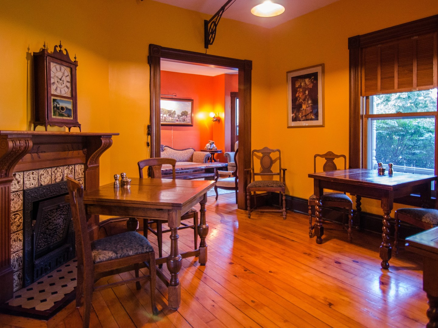 A living room filled with furniture and a large window at Heart of the Village Inn, Modern Vermont Bed & Breakfast.