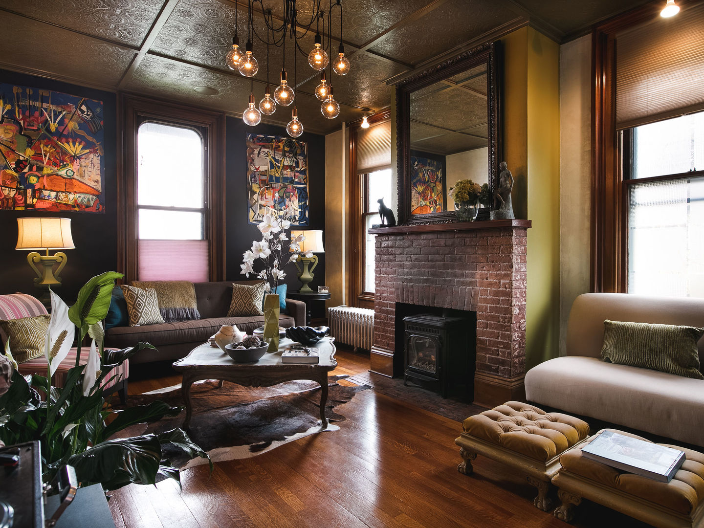 A living room filled with furniture and a large window at Made INN Vermont Bed and Breakfast.