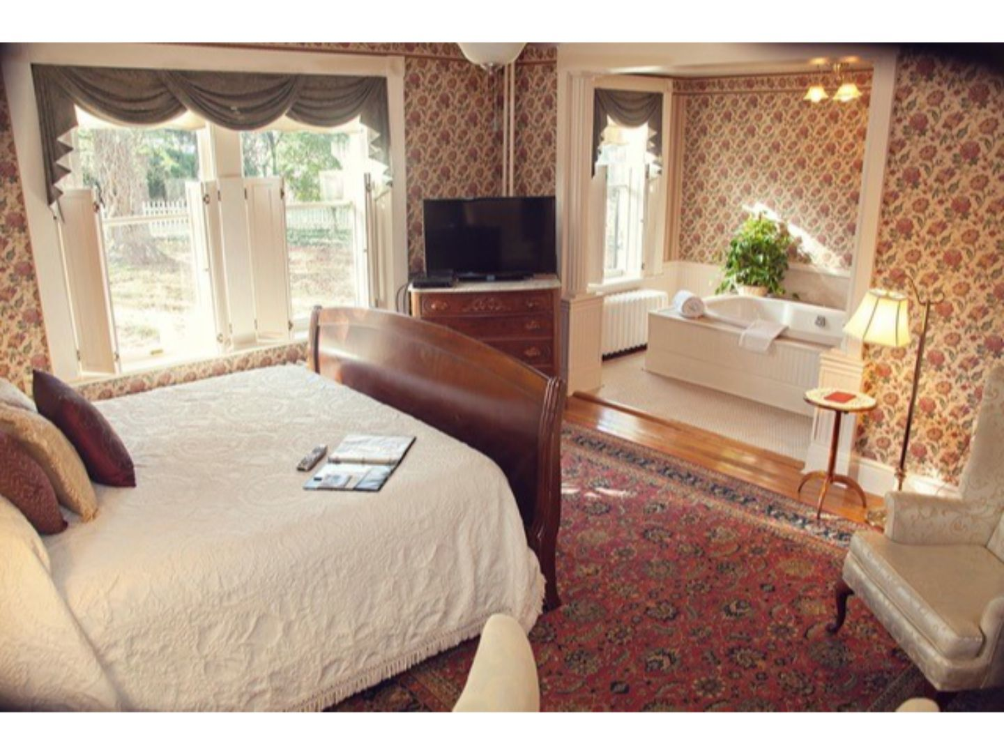 A bedroom with a bed and window in a room at The Carriage Inn Bed and Breakfast.