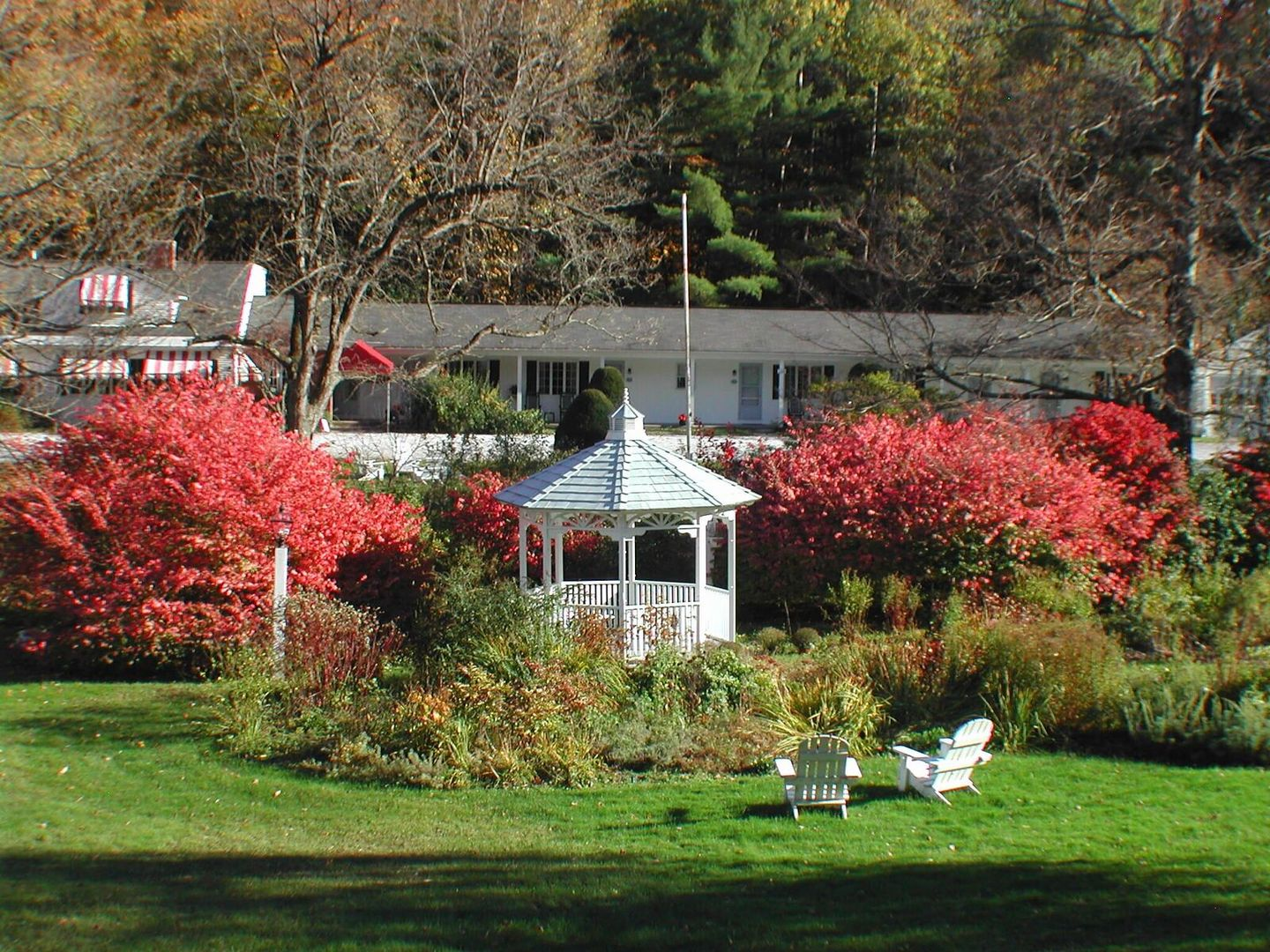 A close up of a flower garden in front of a house at 1896 House Inn and Country Lodgings.