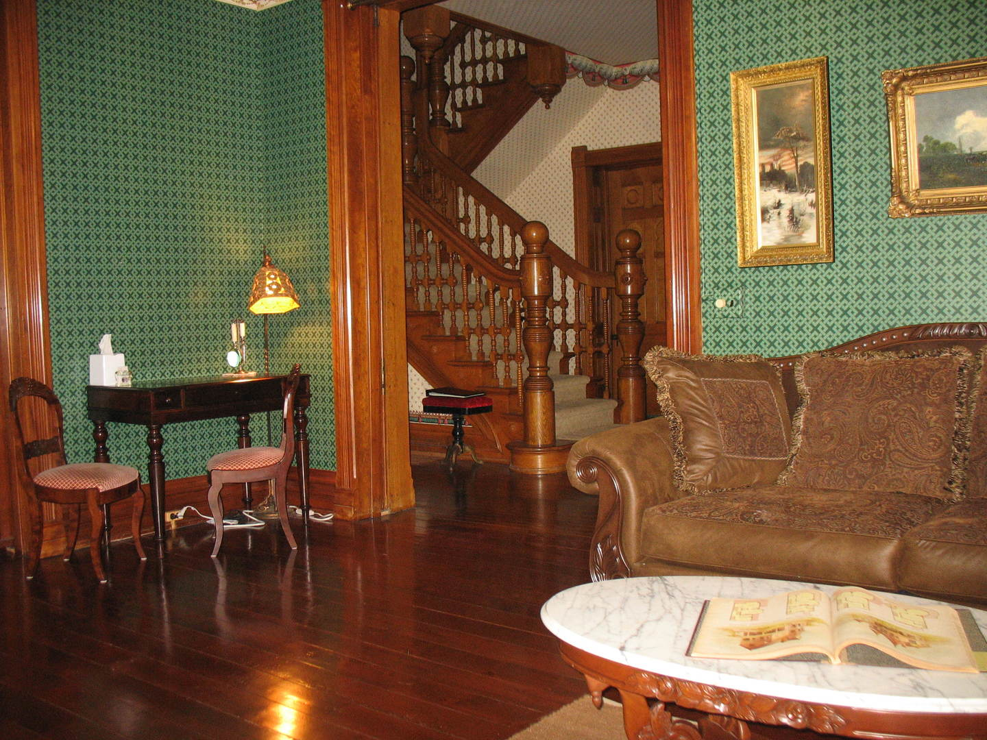 A living room with a couch and a chair at The Grand Kerr House.