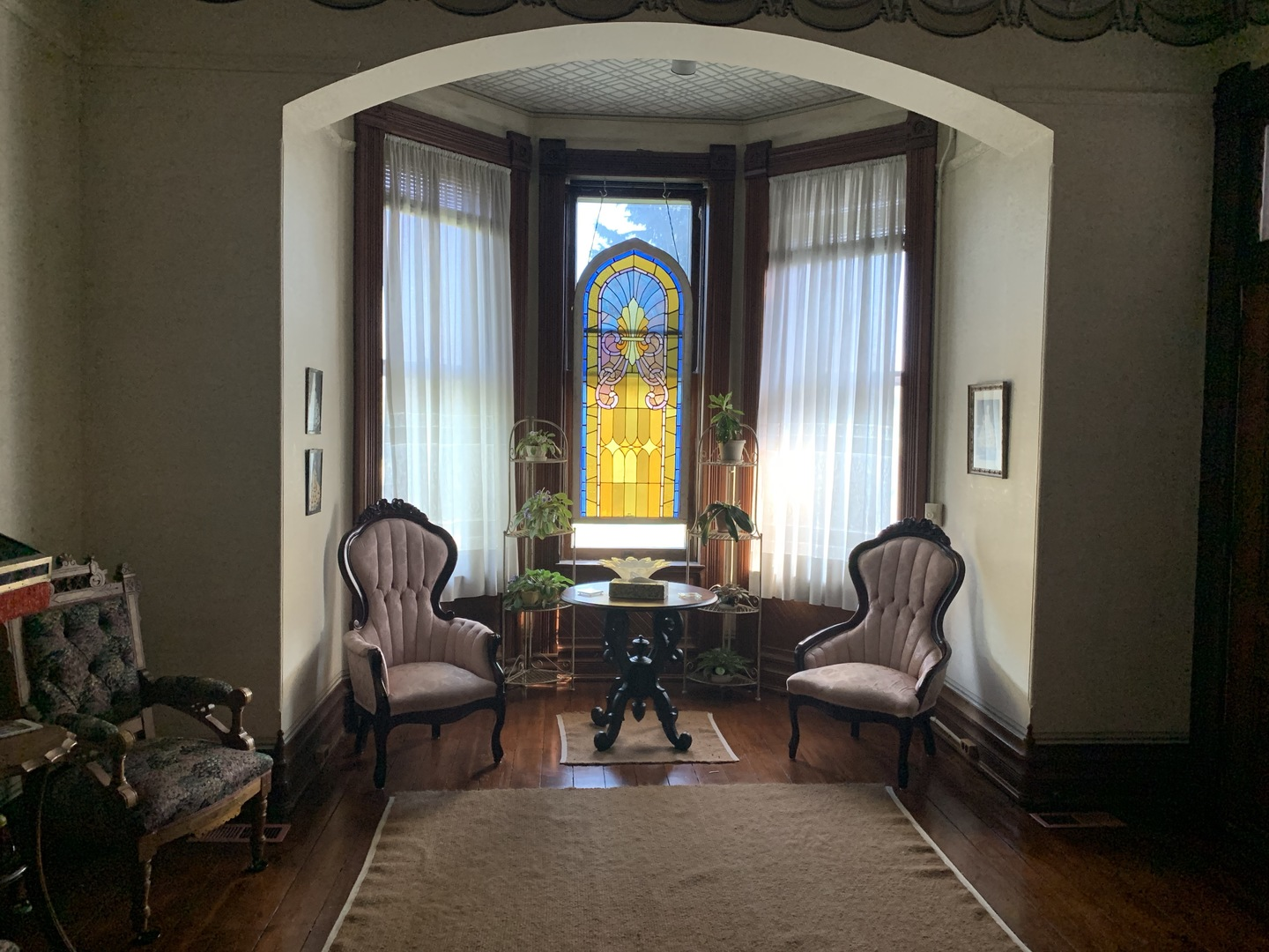 A living room filled with furniture and a large window at The Grand Kerr House.