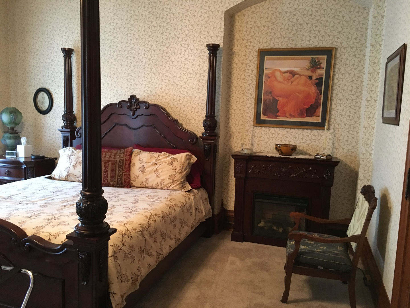 A bedroom with a bed and a fireplace at The Grand Kerr House.