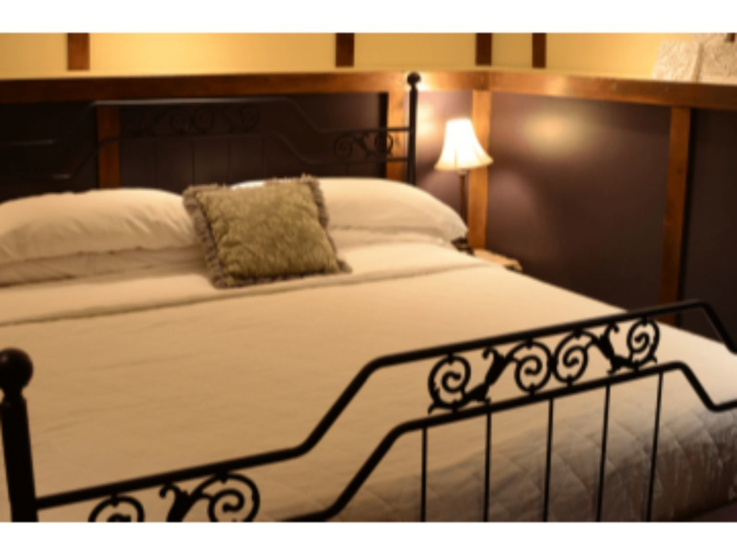 A bedroom with a bed in a hotel room at Whispering Pines Bed & Breakfast.