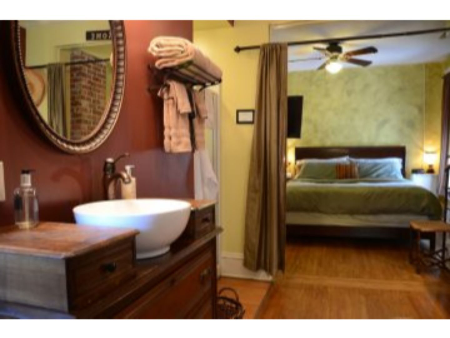 A bedroom with a large mirror at Whispering Pines Bed & Breakfast.