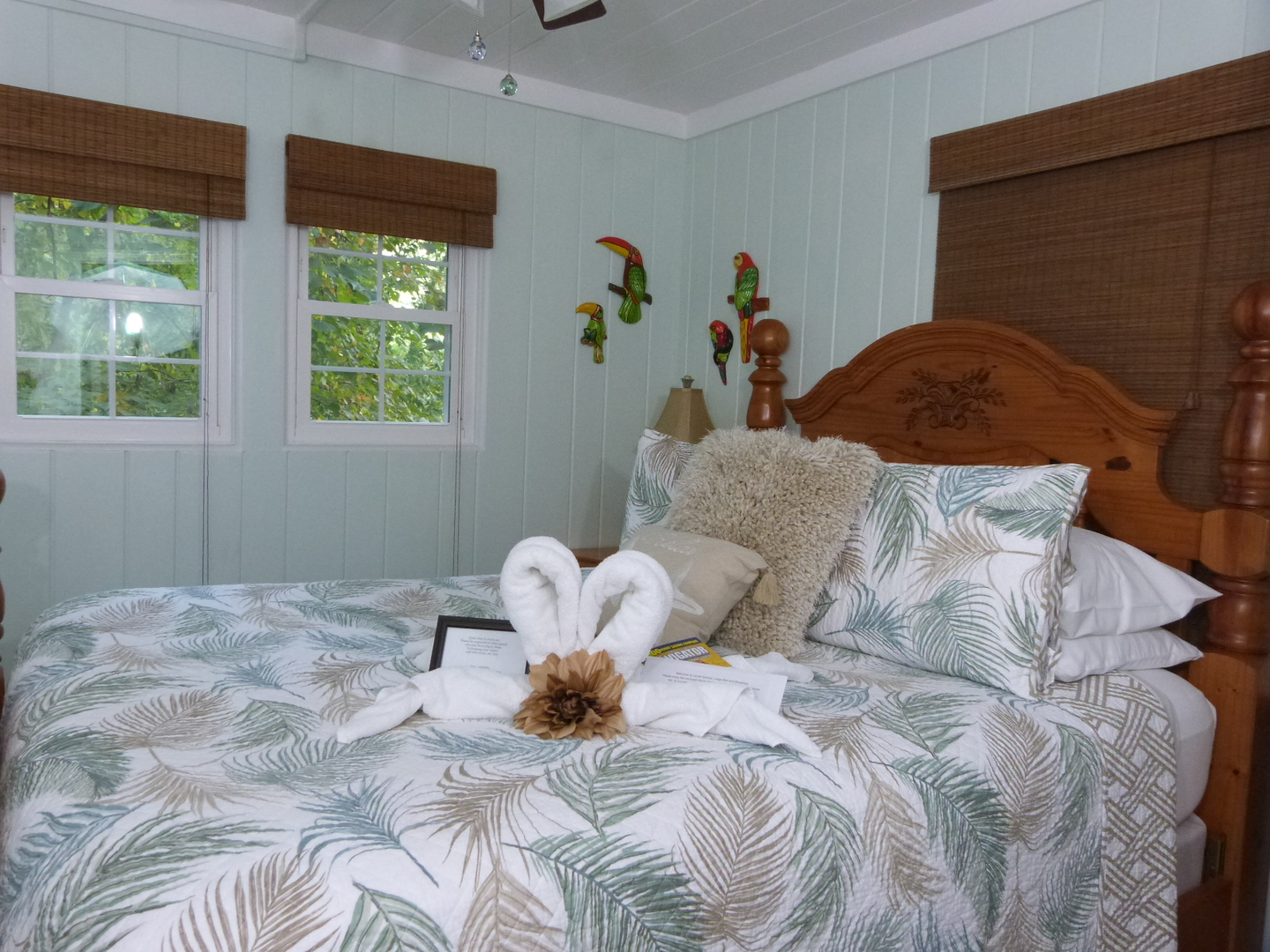 A bedroom with a bed and a window at Laurel Springs Lodge Bed and Breakfast.