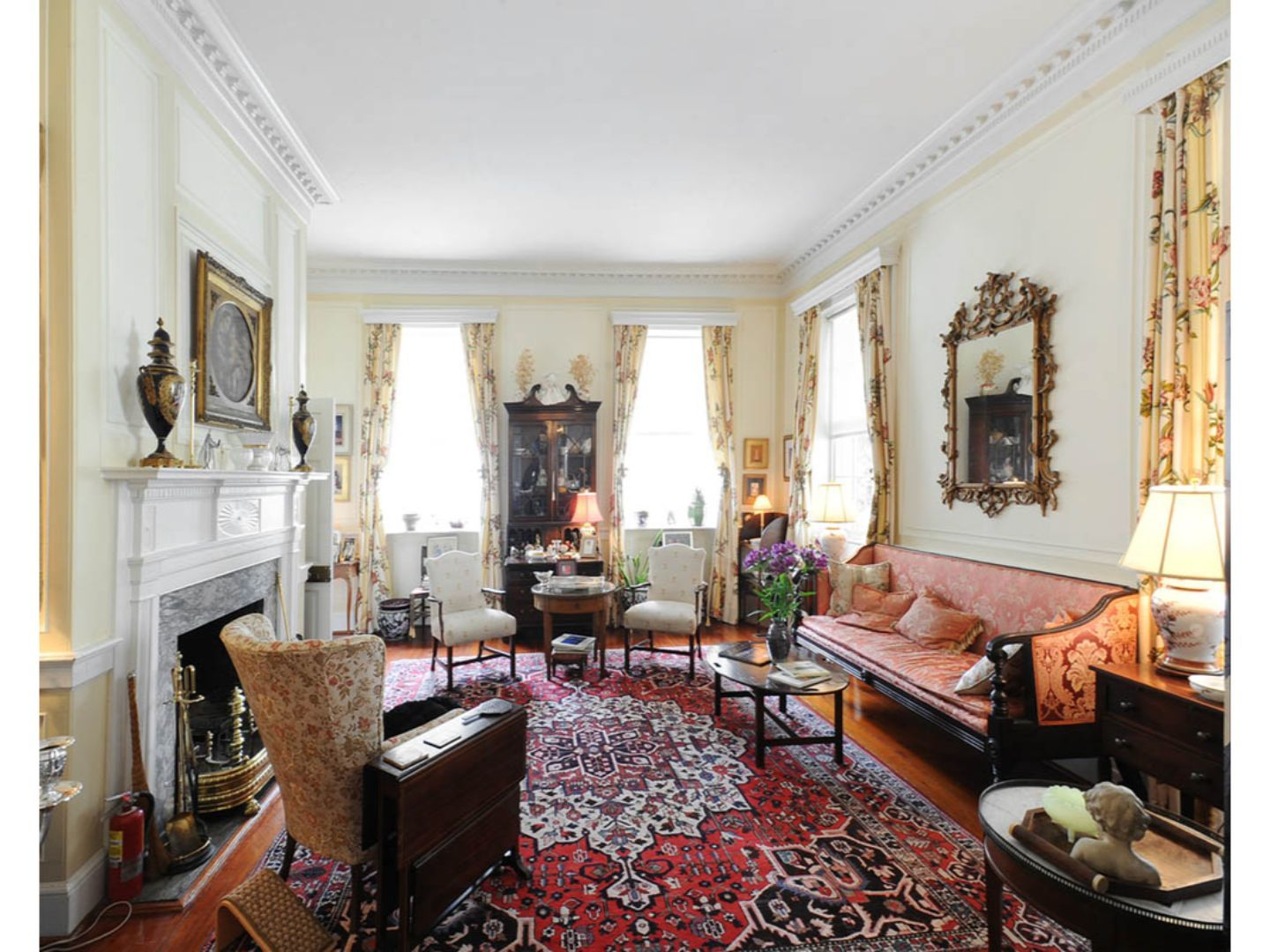 A living room filled with furniture and a fire place at 15 Church Street Bed & Breakfast.