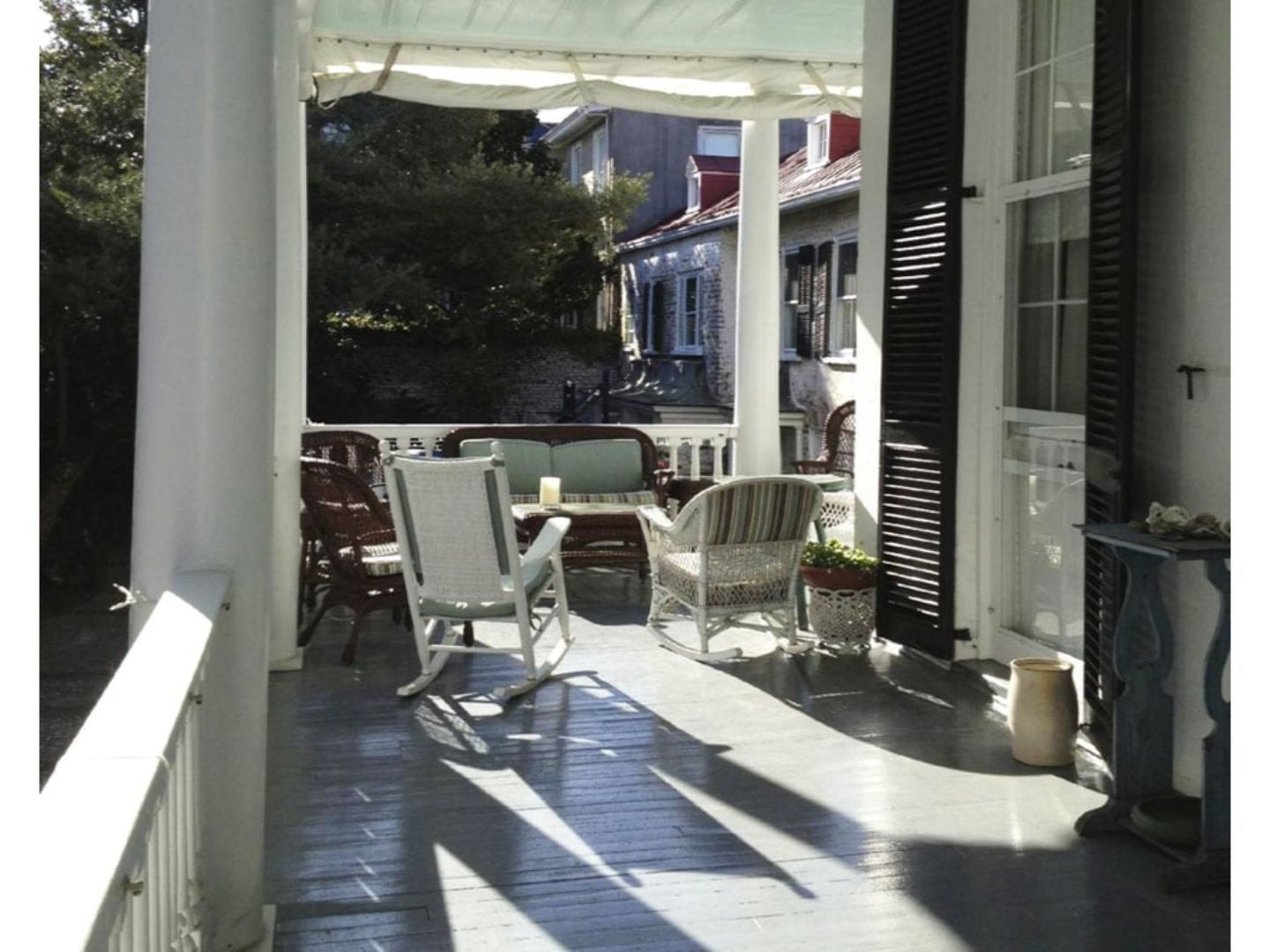 A room filled with furniture and a large window at 15 Church Street Bed & Breakfast.