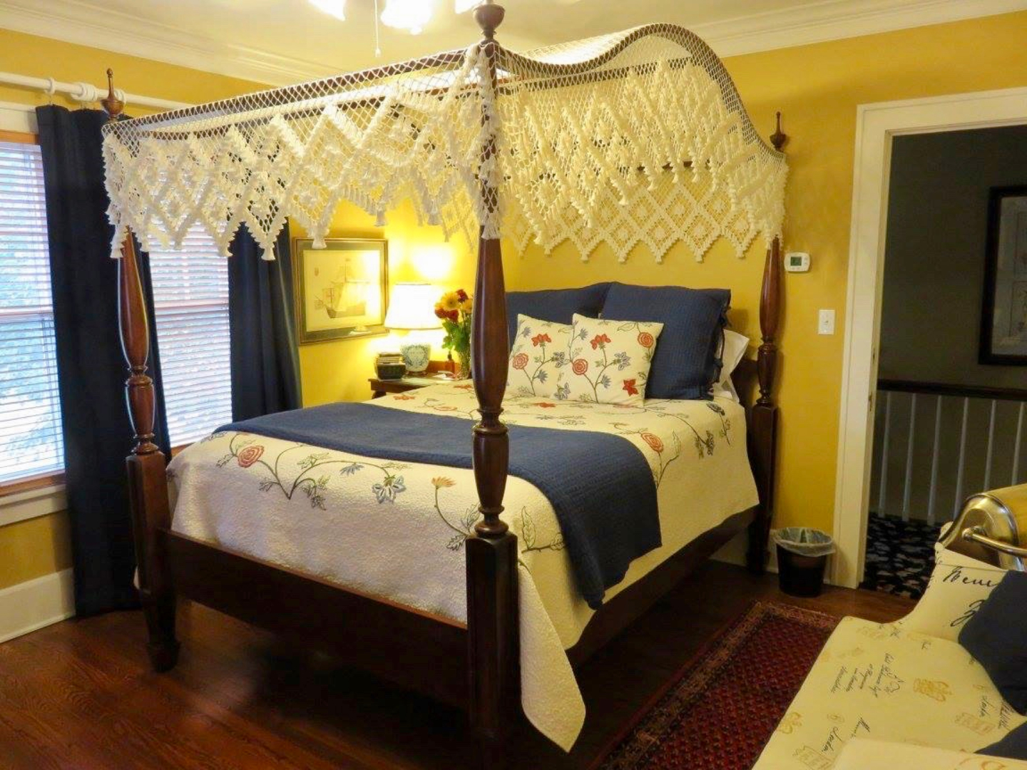 A bedroom with a bed and desk in a room at Sidwell Friends Bed and Breakfast.