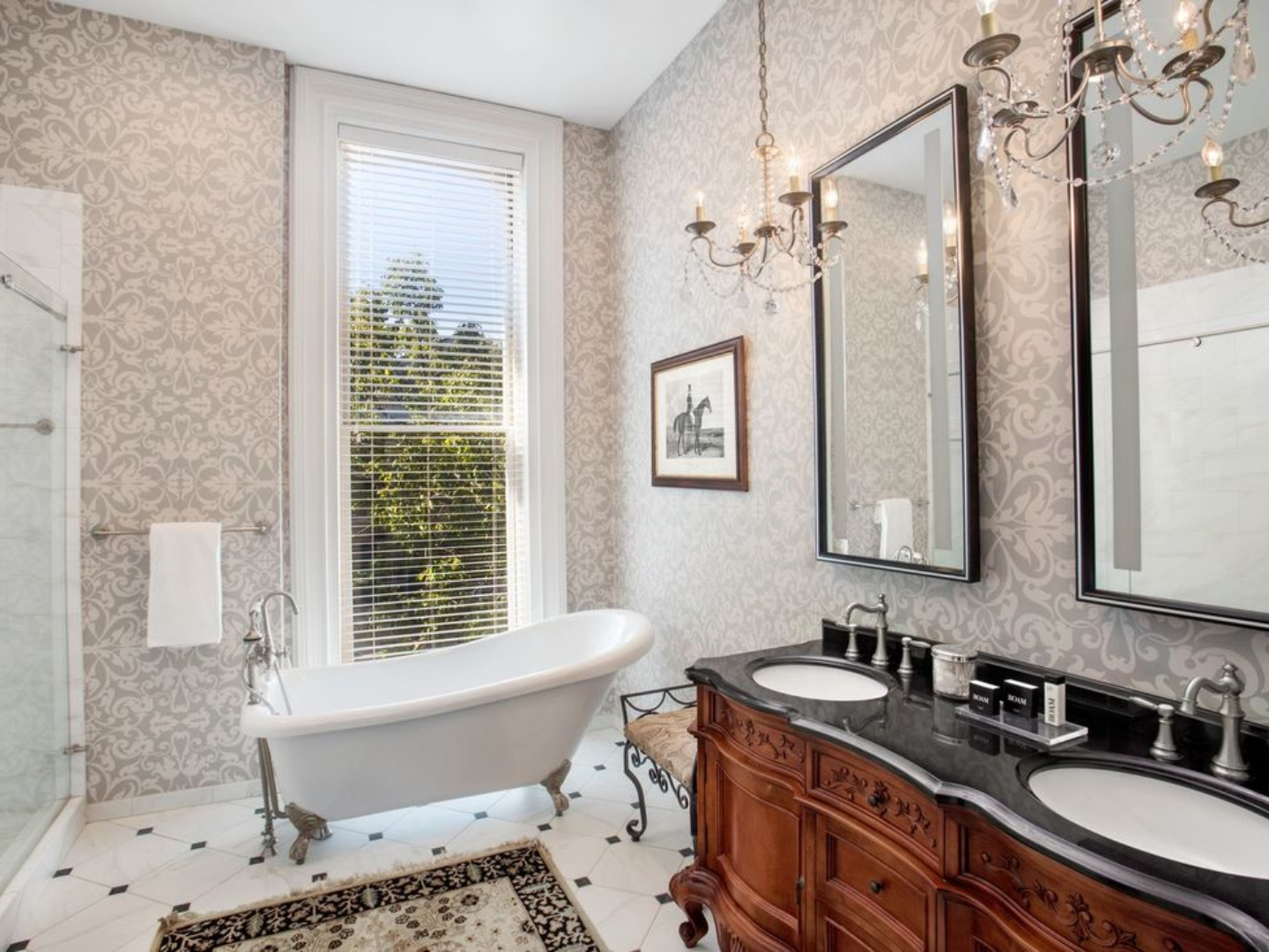 A room with a large tub next to a sink at Hamilton-Turner Inn.