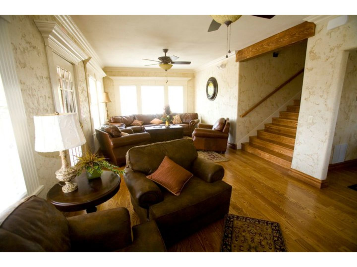 A living room filled with furniture and a fireplace at The Branson House.