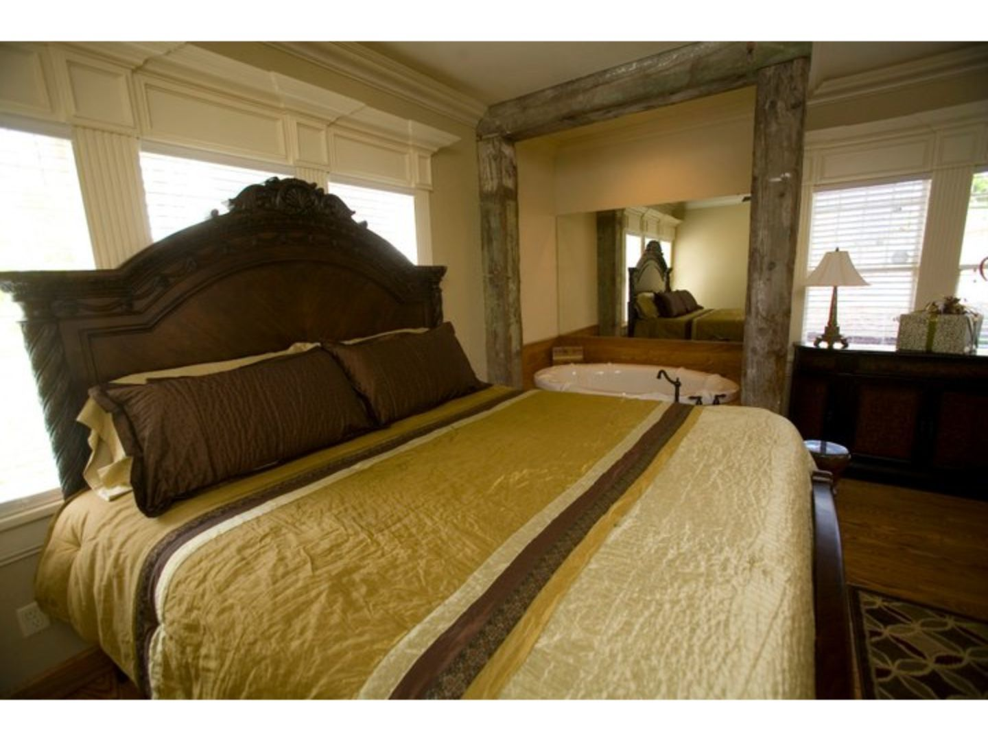 A bedroom with a bed and a large window at The Branson House.