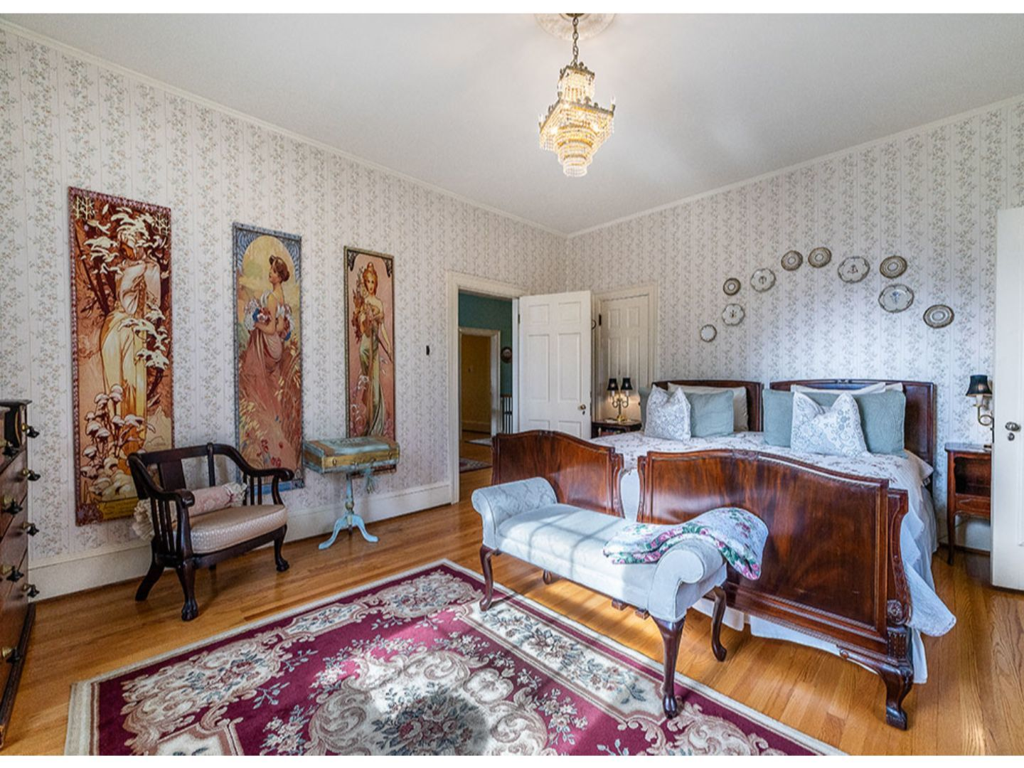 A living room filled with furniture and a fire place at Hillcrest Mansion Inn.