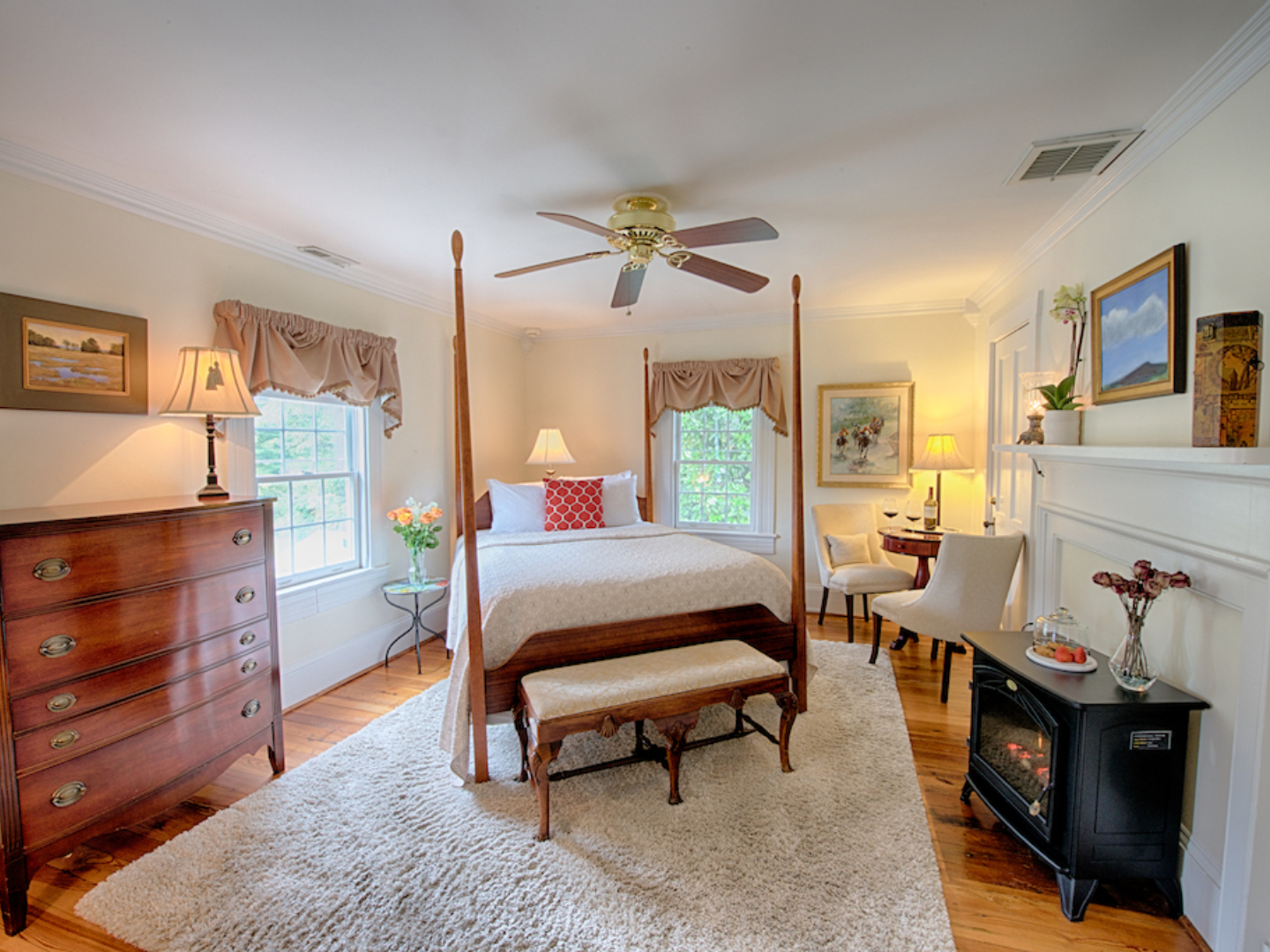 A bedroom with a bed and a chair in a room at Foster Harris House.