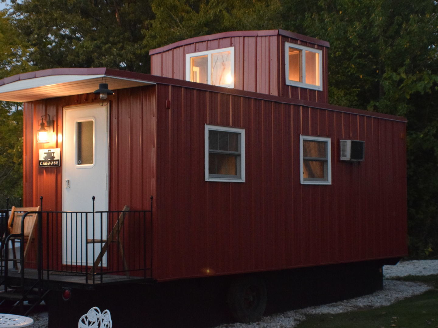 A train is parked on the side of a building at The Lost Pearl Bed and Breakfast.