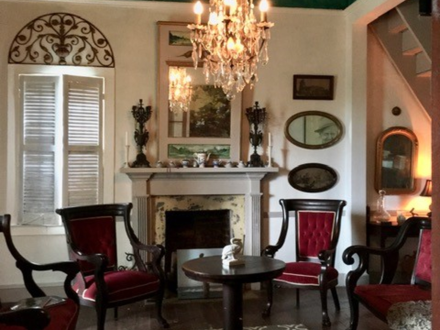 A living room filled with furniture and a fire place at John LaFleur's Louisiana Creole Guesthouse.