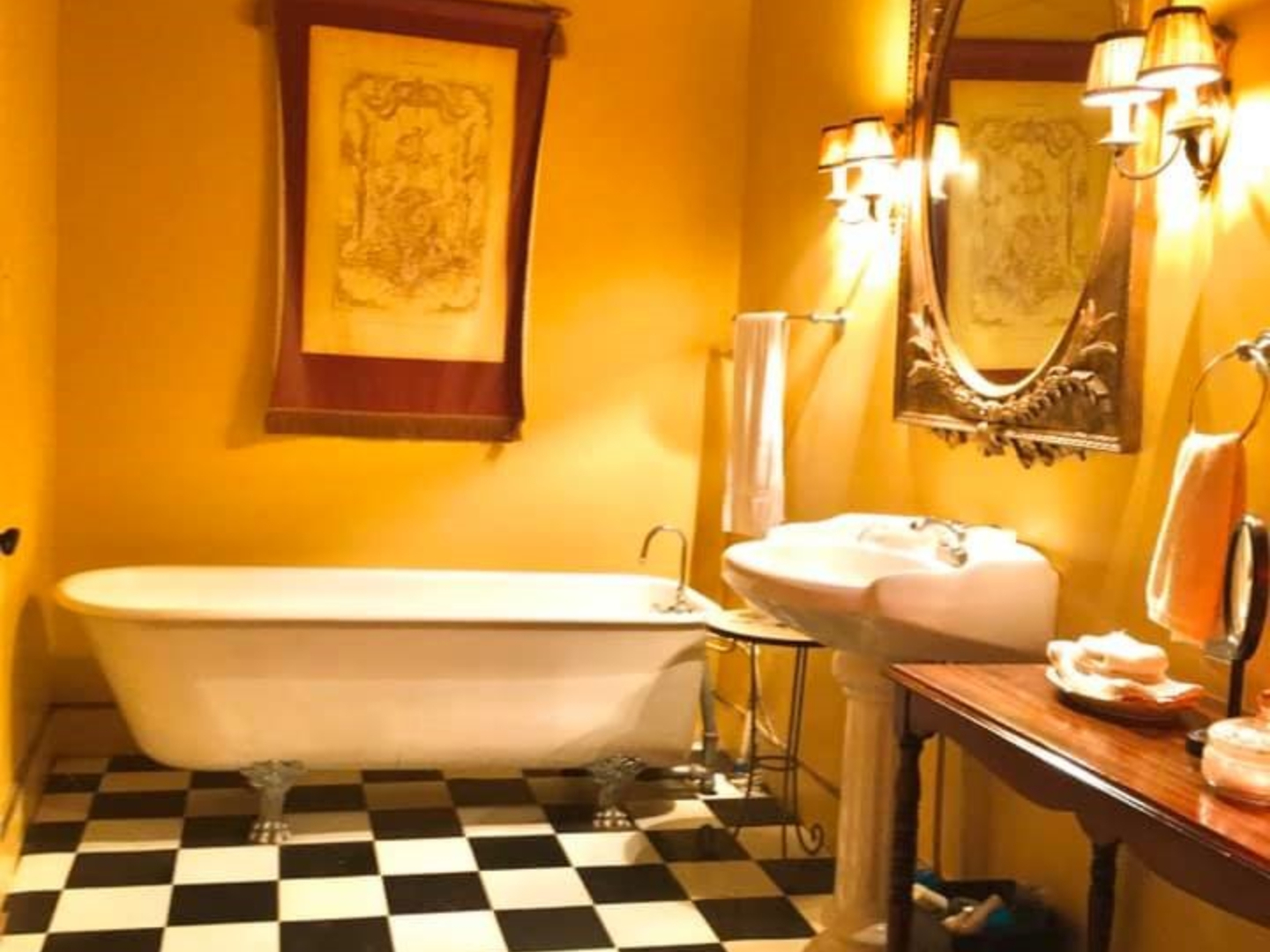 A close up of a sink in a small room at John LaFleur's Louisiana Creole Guesthouse.