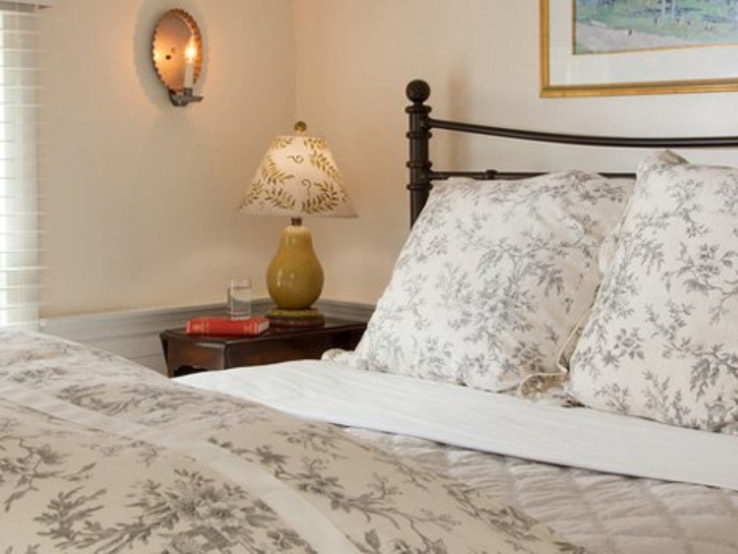 A bedroom with a bed in a room at The Garden Gables Inn.