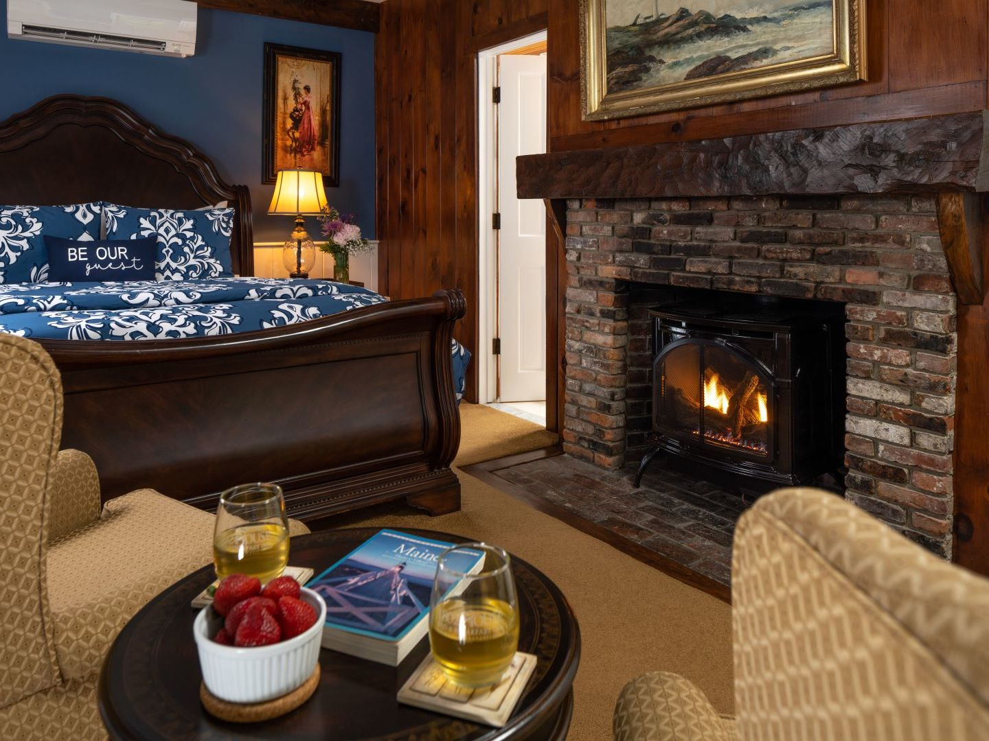 A fire place sitting in a living room with a fireplace at 1802 House Bed and Breakfast Inn.