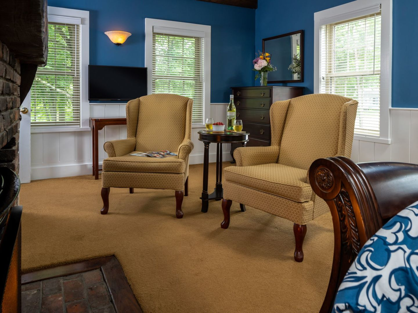 A living room filled with furniture and a large window at 1802 House Bed and Breakfast Inn.
