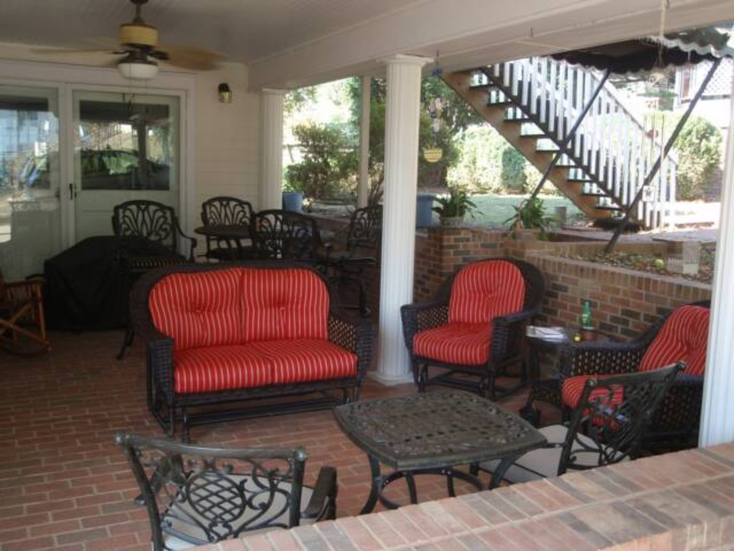A living room filled with furniture and a fire place at Silver Cliff Inn Bed & Breakfast.