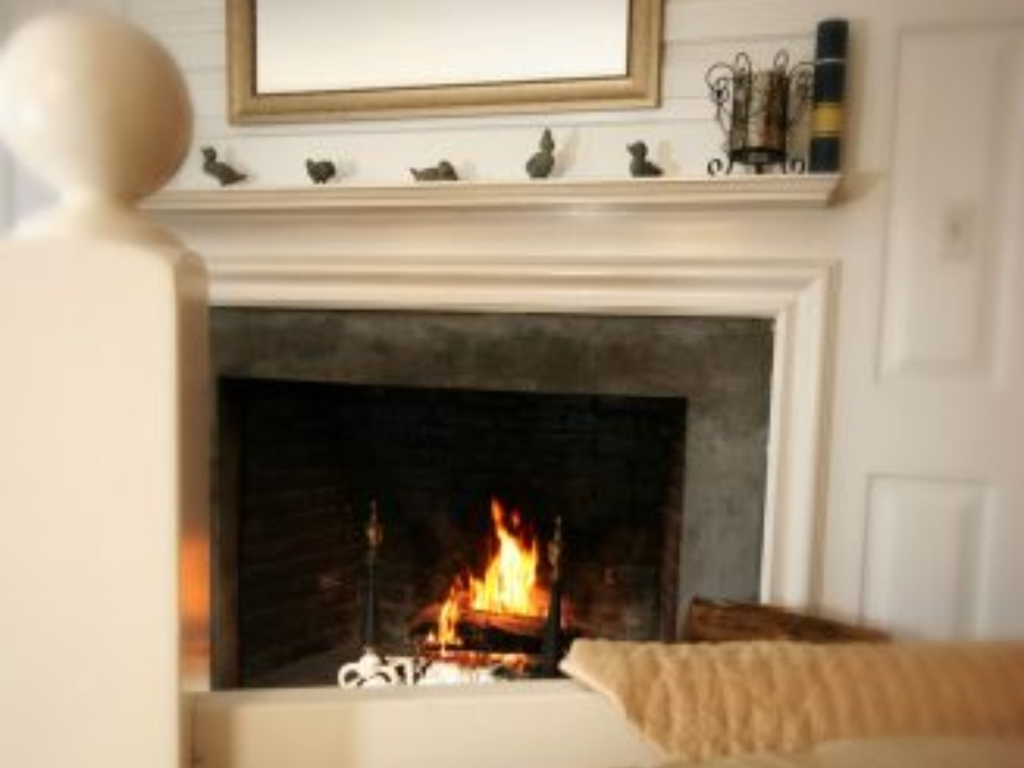A fire place sitting in a living room with a fireplace at Lamb and Lion Inn.