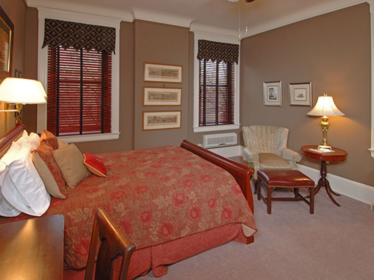 A bedroom with a bed and a chair in a room at The Clifton House Bed and Breakfast.