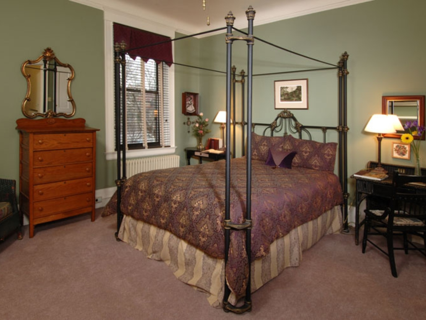 A bedroom with a bed and desk in a room at The Clifton House Bed and Breakfast.