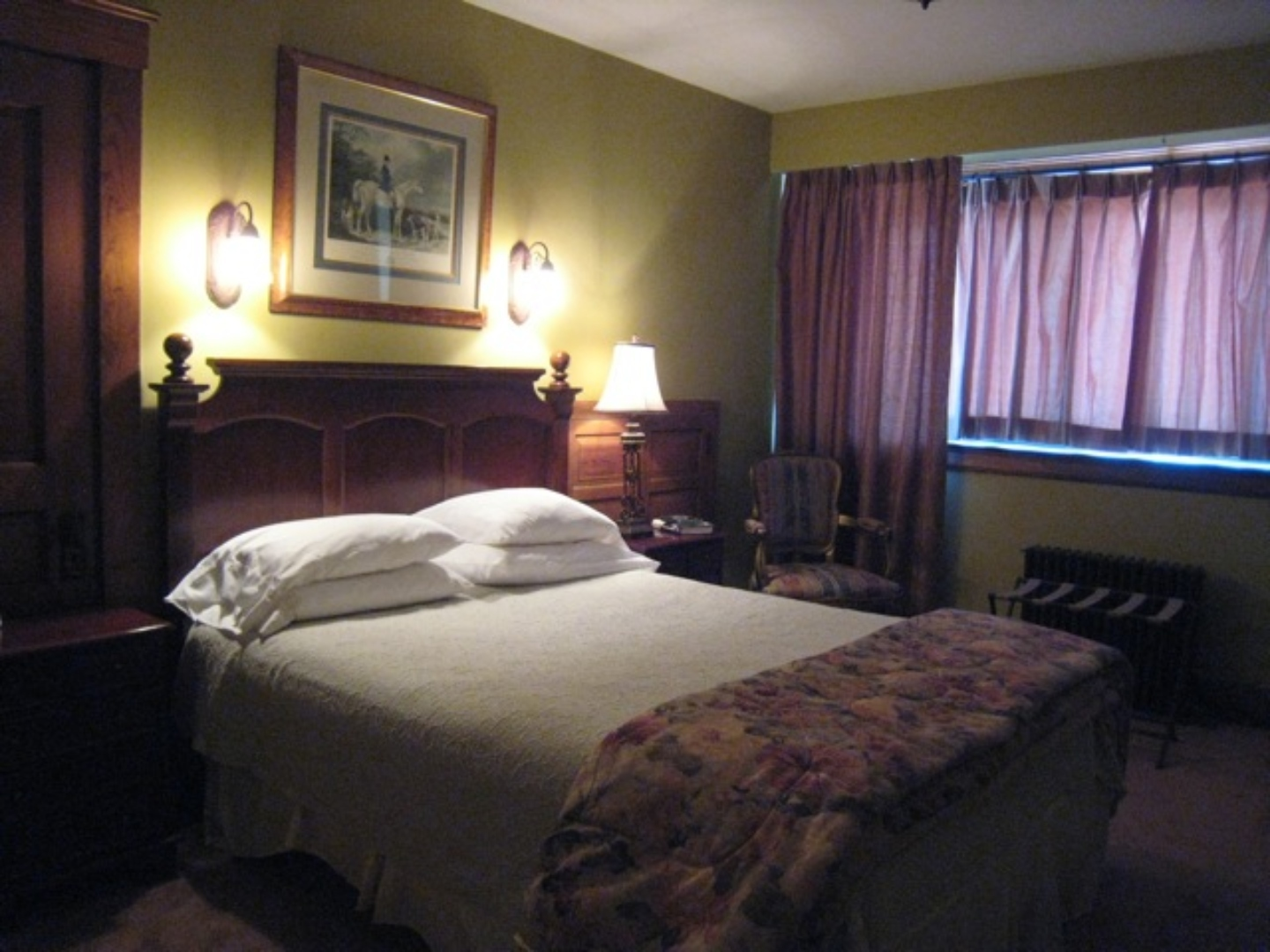 A bedroom with a large bed in a hotel room at The Clifton House Bed and Breakfast.