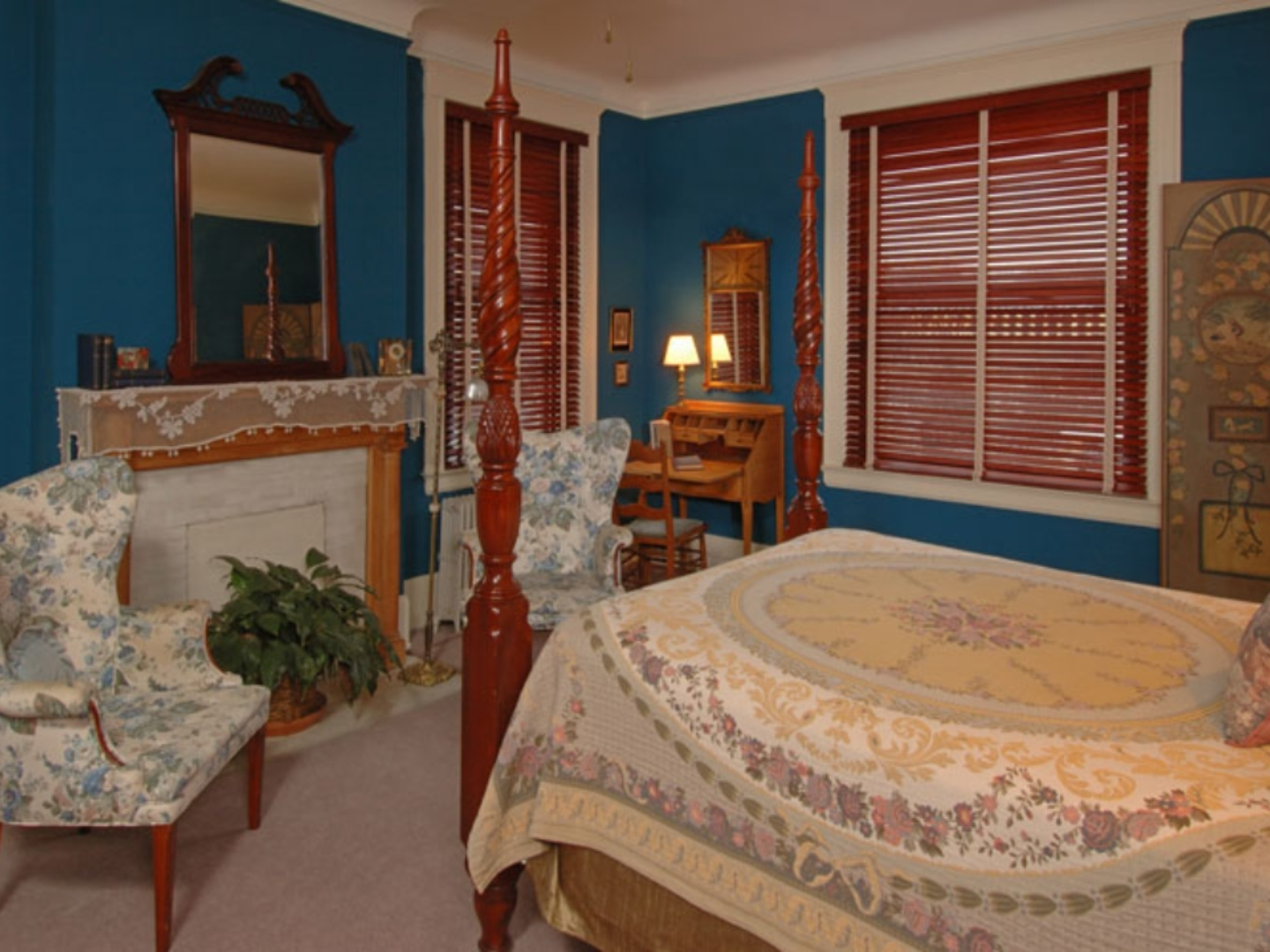 A bedroom with a bed and a fireplace at The Clifton House Bed and Breakfast.